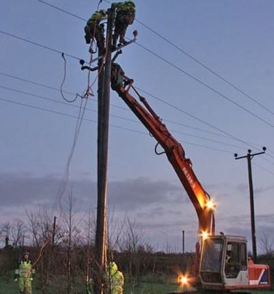 NIE team working on electricity poles