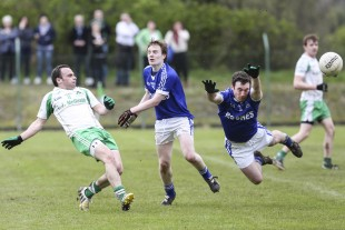 Paul McCusker hopes for a point as Niall Bogue clips the ball.  DP53