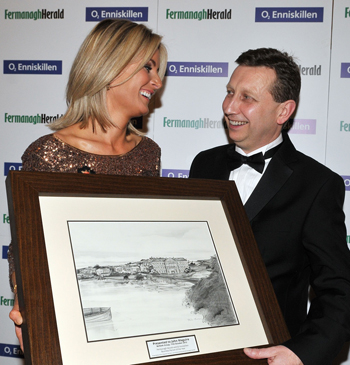 John Maguire of the Belleek Group, pictured with his wife Catherine, after being presented with the Fermanagh Herald and 02 Enniskillen Business Person of the Year Award