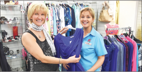 There's always a happy smile from Heather Lynn at Style Outlet as Stephanie O'Kane tries out the latest fashion, at Bridge Street, Omagh.