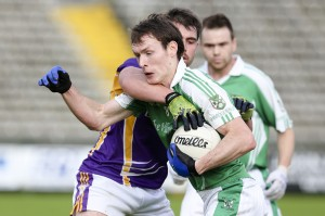 James Sherry pushes past Maurice Cassidy during the league final