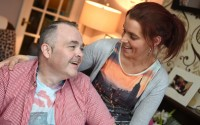 Anthony McBrien, in relaxed mood at home, shares a joke with his partner Lisa Cassidy who has helped him with his recovery    RMGFH163