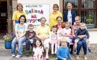 Retiring playgroup leader Edith McBride with two of the staff members and a few of the last parents and children to benefit from her years of nurturing experience.