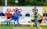 Shane McCabe takes to the air to thump a ball back towards the Dungannon goals.