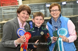 Finance Minister Arlene Foster and Olwen Gormley (Vaughan Trust) with Ben Foster and his hen Rosie    RMGFH123