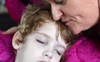 Ellie's mother Ciara gives her a tender kiss as she rests    RMGFH87