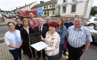 Businesses in Lisnaskea are upset that fibre optic Broadband is unavailable to them and that current slow internet speeds are hindering them.  From left, Sandra Quigley (Eurospar), Roisin Maguire (Eurospar), Patricia Rafferty (Lisnaskea Credit Union), Noel Robinson (Dowlers Funeral Services), Teresa McGovern (Mac's Bar), Councillor Richie McPhillips (R.P. McPhillips Insurance), Stephen McCaffrey (Lisnaskea Credit Union), Nina Kelly-Kleine (Donn Carragh Hotel and Leonard Auctioneers), Leanne McGovern (Mac's Bar), Fergal McElgunn (property owner) and Eugene McGovern (Mac's Bar)    RMGFH11