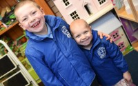Michael Singleton puts a reassuring arm around his little sister Eloise on the first day of the new school year as they prepare to set off for St Paul's Primary School, Irvinestown    Picture: Ronan McGrade