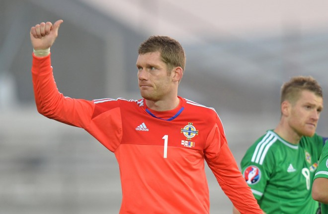 Michael McGovern salutes the fans after Northern Ireland secured Euro 2016 qualification.