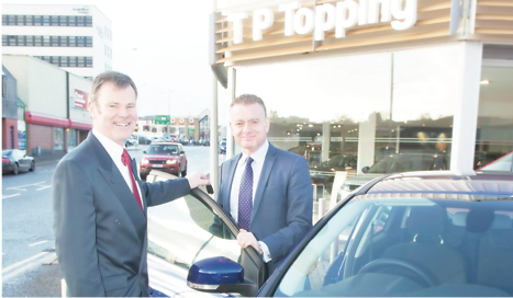 Hamish Logan Customer service man- ager with franchise manager Adrian De- vitt at TP Toppings