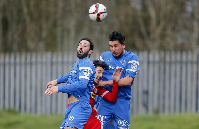 Cliftonville's Thomas Cosgrove and Ballinamallard's Johnny Lafferty and Emmett Friars in action. Picture: Kevin Scott / Presseye)