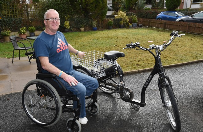 Eugene Hassard with the trike that he will be using for the upcoming races    RMG24