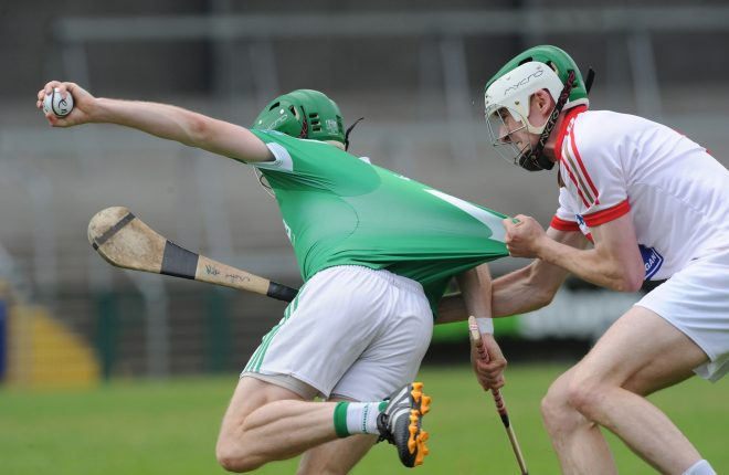 Louth's Mike Lyons fouls Sean Corrigan