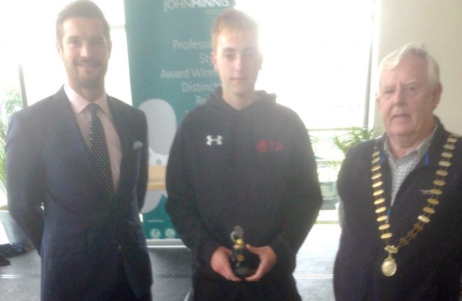 Kyran Maguire, centre, pictured after his under 16 singles victory at the Belfast Hardcourt Championships.