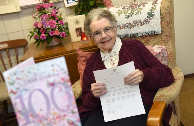 FONDLY REMEMBERED...Anna Drumm, pictured holding a letter she received from the Irish President Michael D Higgins on her 100th birthday, passed away recently at the age of 101