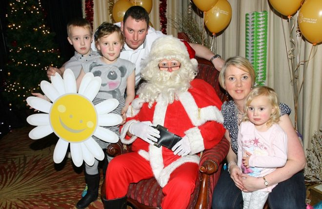 Ryan, Kerri, Dad Stephen, Mum Trudi and Amy Roche with Santa