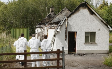 DAMAGE...Forensic officers at an Orange Hall in Roslea after an arson attack