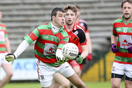 Mark Little Prepares To Hand Pass As Lisnaskea Control The Midfield