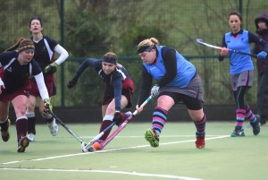Enniskillen's Clare Wilson comes under pressure from two Owls players.