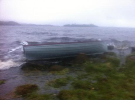 The boat stuck among rocks on the