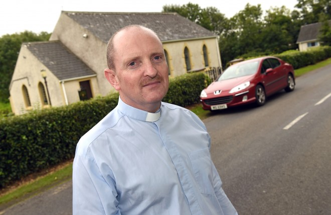 Reverend Rodney Beacom stands outside Maguiresbridge Presbyterian Church where three cars were recently broken into during a Church service    RMGFH26