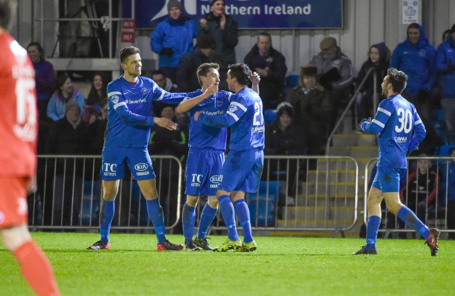 James McKenna is congratulated by his team mates after the crucial Mallard's goal against Portadown.