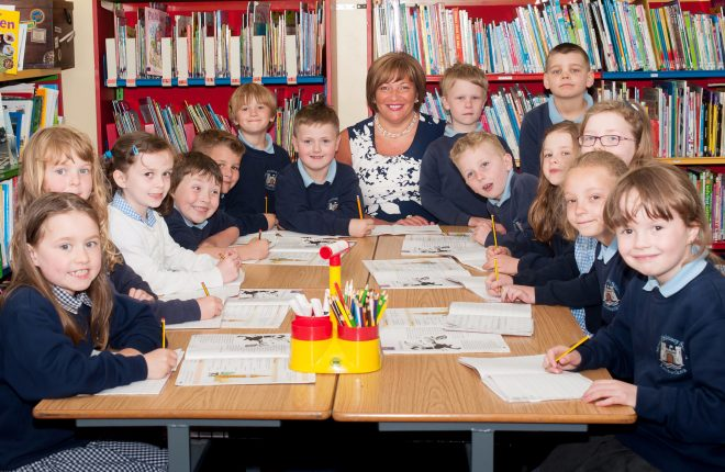 Moat Primary School Principal Felicity Humphreys surrounded by pupils from her school