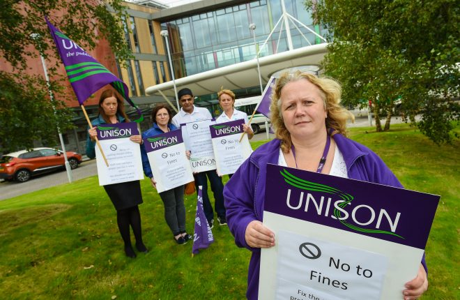 Oriel Ferguson, Helen Kelly, Mohammed Yaqub, Maura Greene and Jill Weir (Unison Branch Secretary) protesting previously at South West Acute Hospital against car parking charges and fines    RMG10