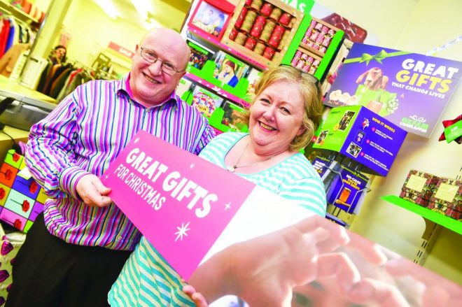Volunteers at Oxfam, Kevin Mohan and Pauline Howell, are ready for the festive season RMG01