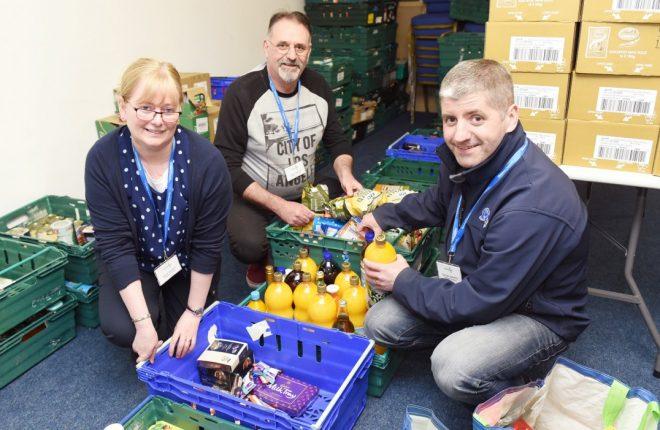Volunteers packing crates for Enniskillen food bank.