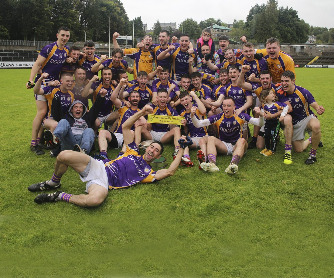 Derrygonnelly celebrate clinching their fifth successive county title.
